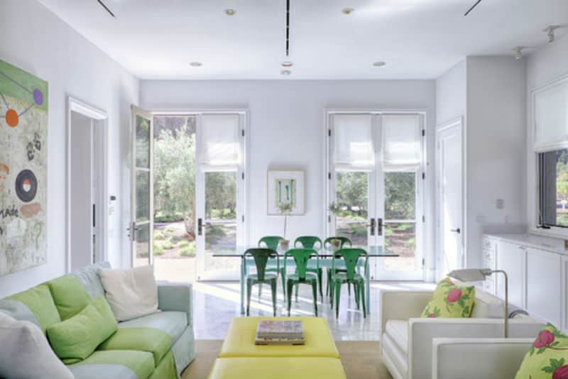 Transitional living room with touches of green.