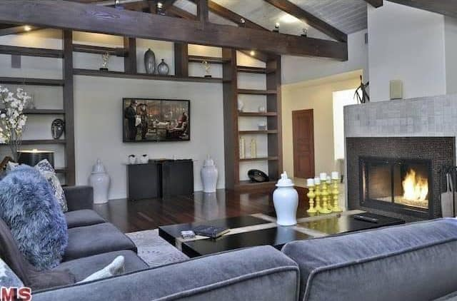 Another look of the contemporary living space showcasing the beautiful sofa set near the fireplace.