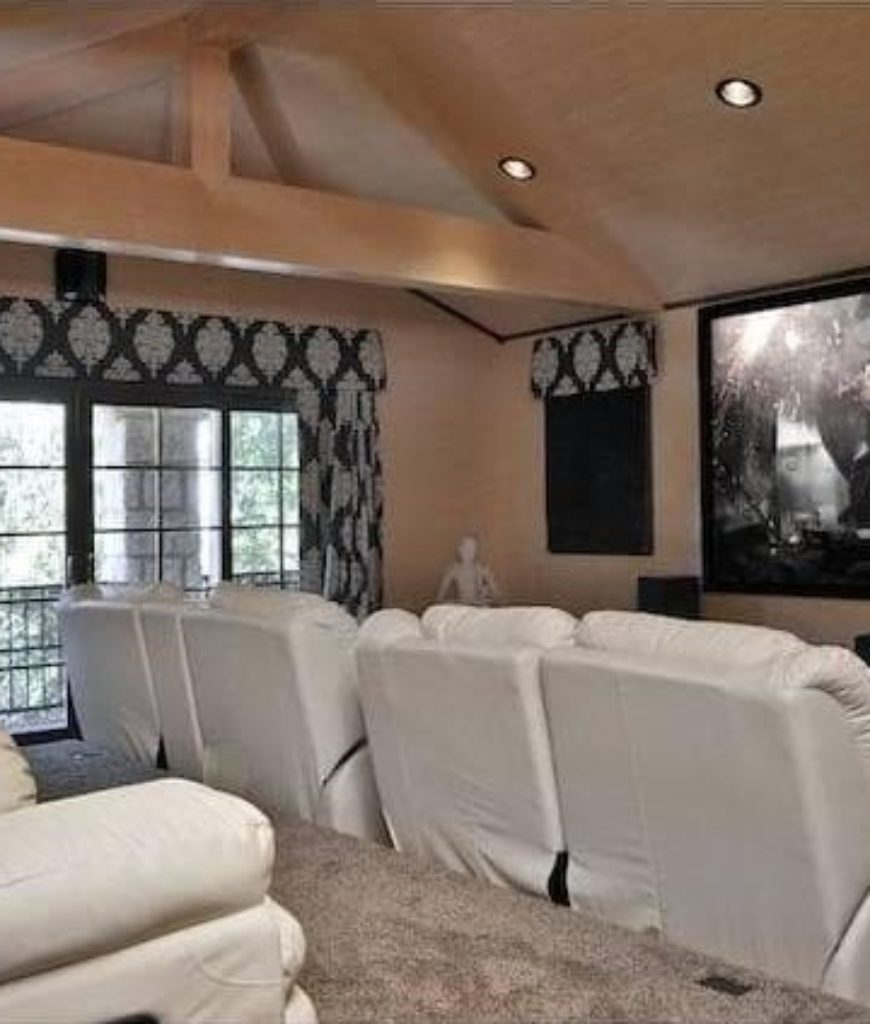 The house also features a spacious home theater with french door leading to terrace.