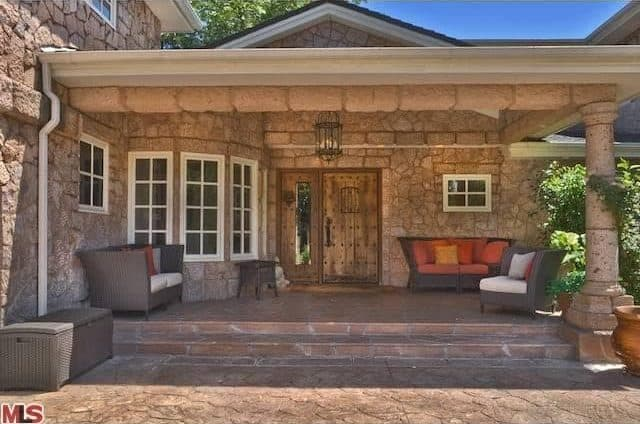 Close up look of the house's porch featuring brick built.