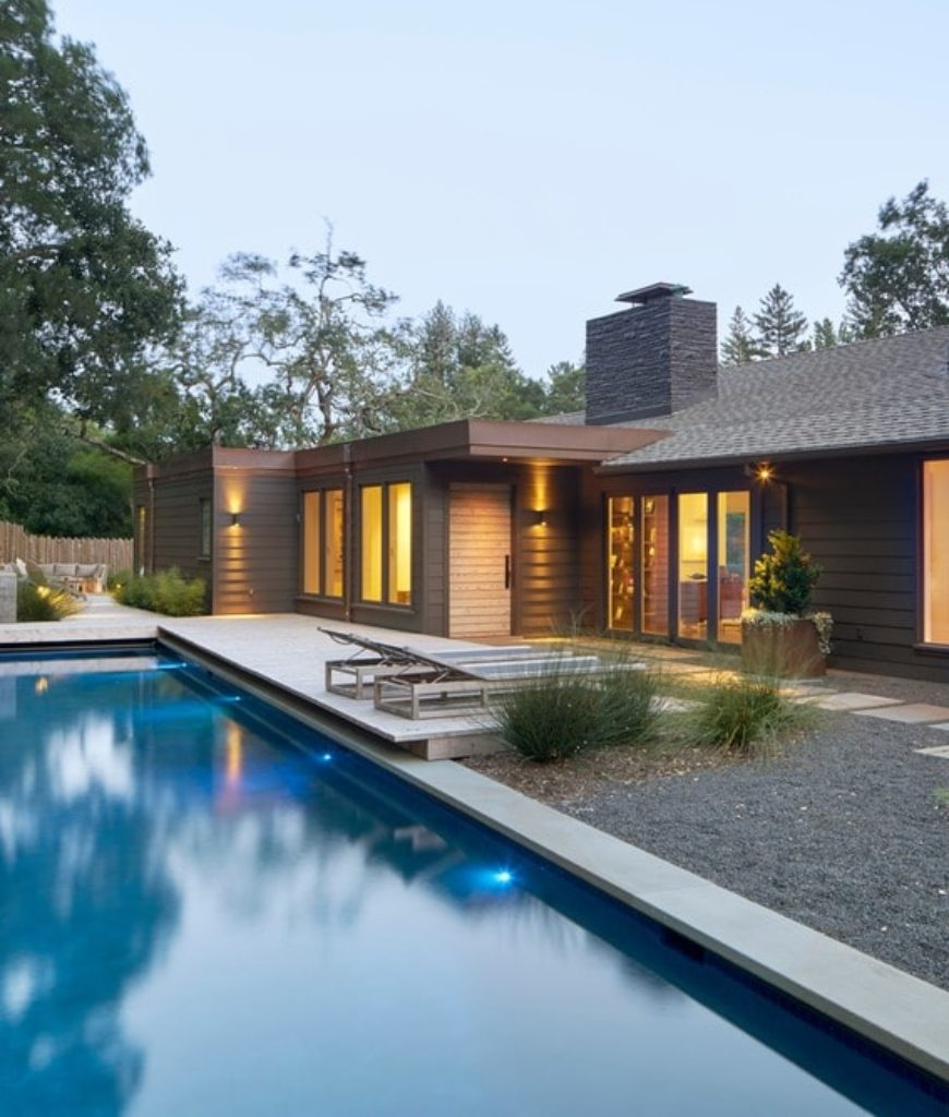 Long rectangular swimming pool with walkway, deck and seating lounge. Photo credit: Bruce Damonte