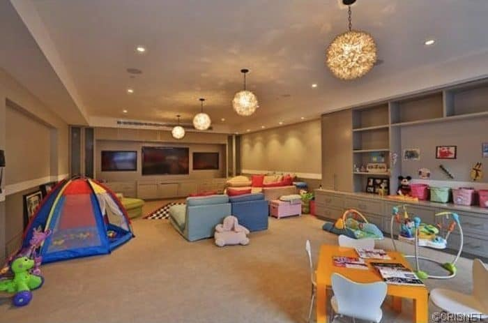A game room with a small theater lighted by recessed and pendant lights also exist in the mansion.