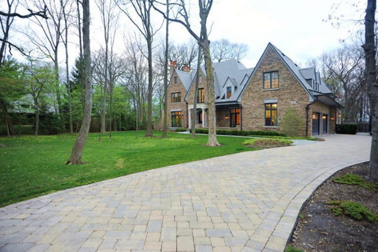 Front driveway and image of grand brick Chicago mansion