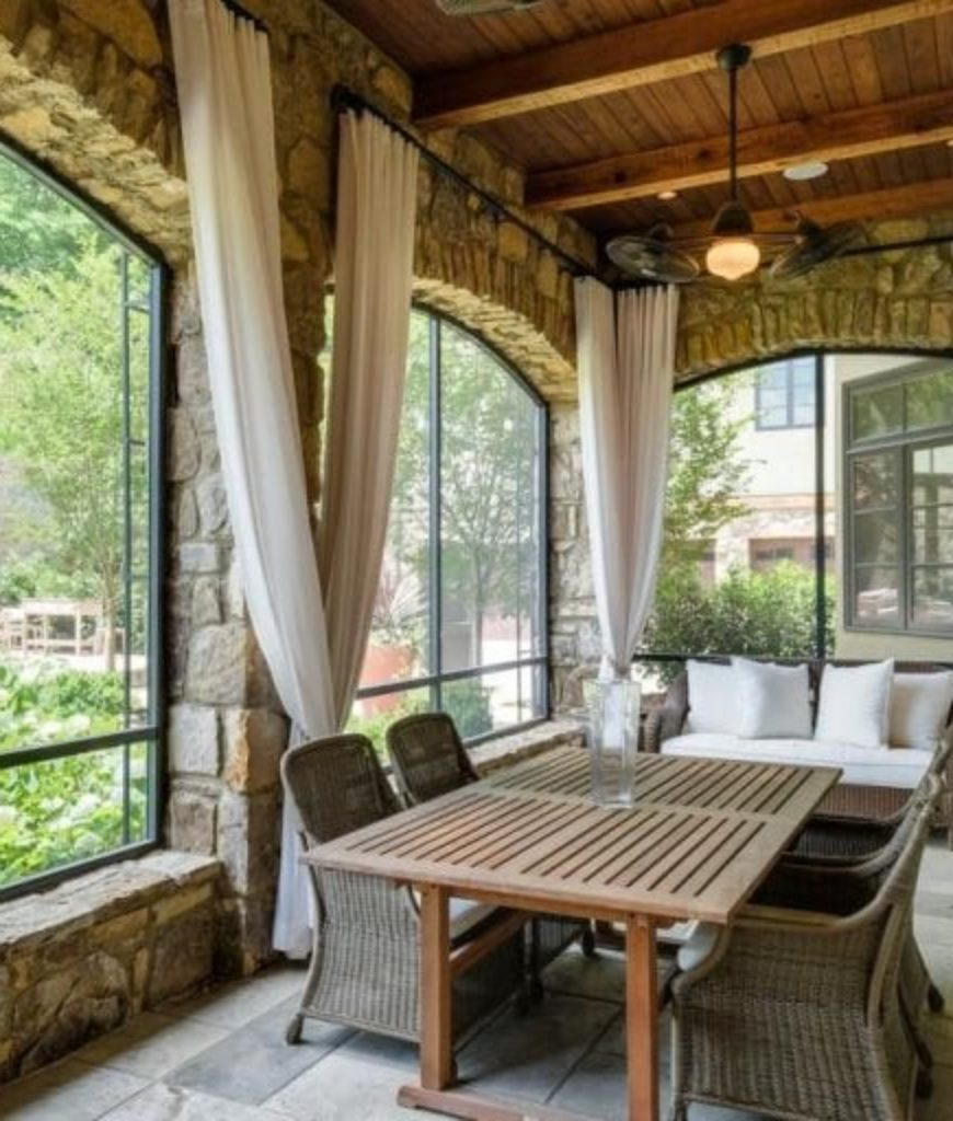 The patio offers a square dining table set along with a sitting lounge on side.