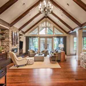 Living room with cathedral wood-beamed ceiling