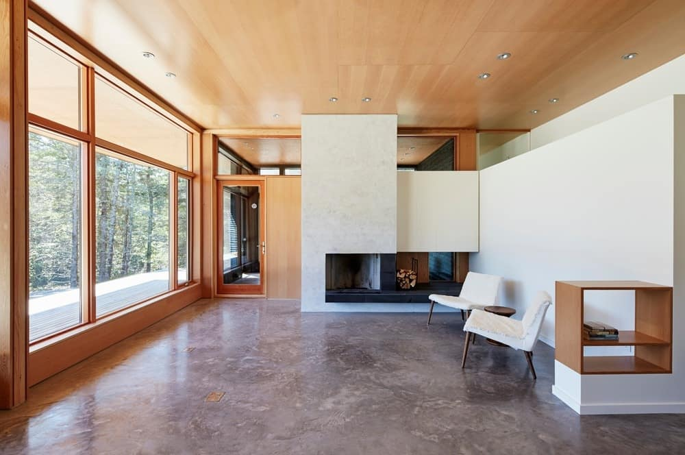 Spacious living space with two lounging seats and a fireplace. Photo credit: Janet Kimber