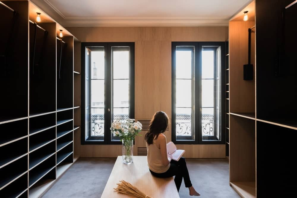 Large Closet With Large Storage Cabinet And Seating Area. Photo Credit:  Mickaël Martins Afonso