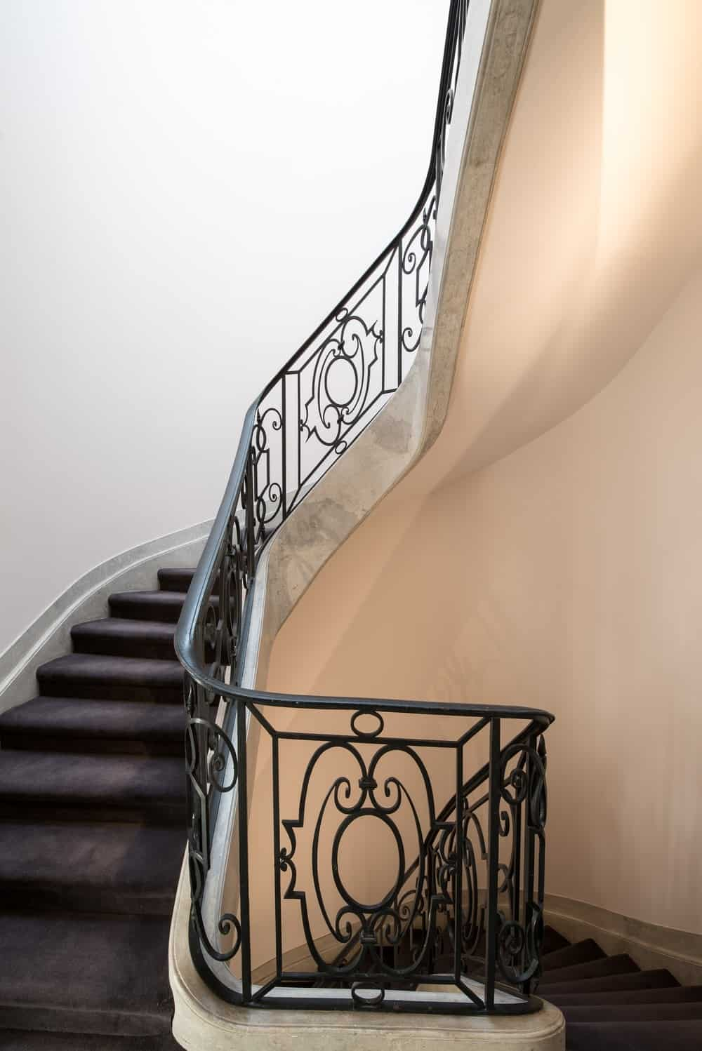 Contemporary Spiral Staircase With White Walls. Photo Credit: Mickaël  Martins Afonso