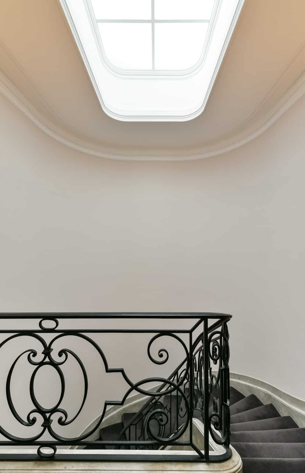 Top of the staircase featuring a skylight. Photo credit: Mickaël Martins Afonso