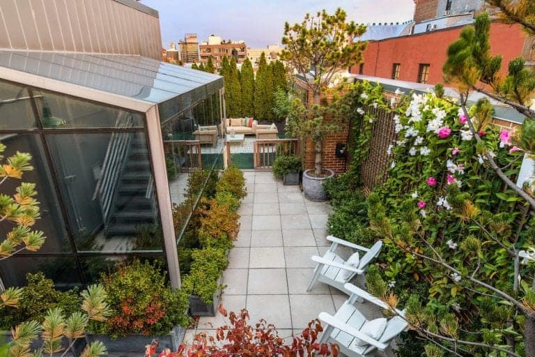 Aerial view of the penthouse's beautiful garden populated by healthy plants and flowers.