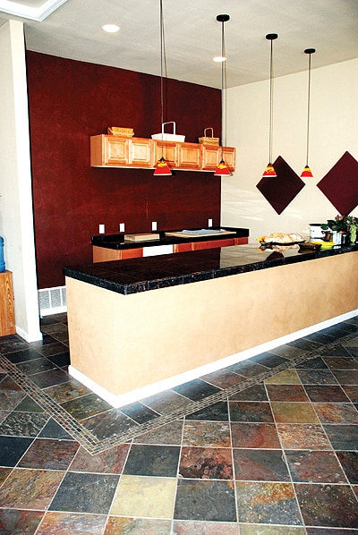 Stone flooring and counter in kitchen