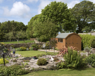 Nice shed in landscaped backyard