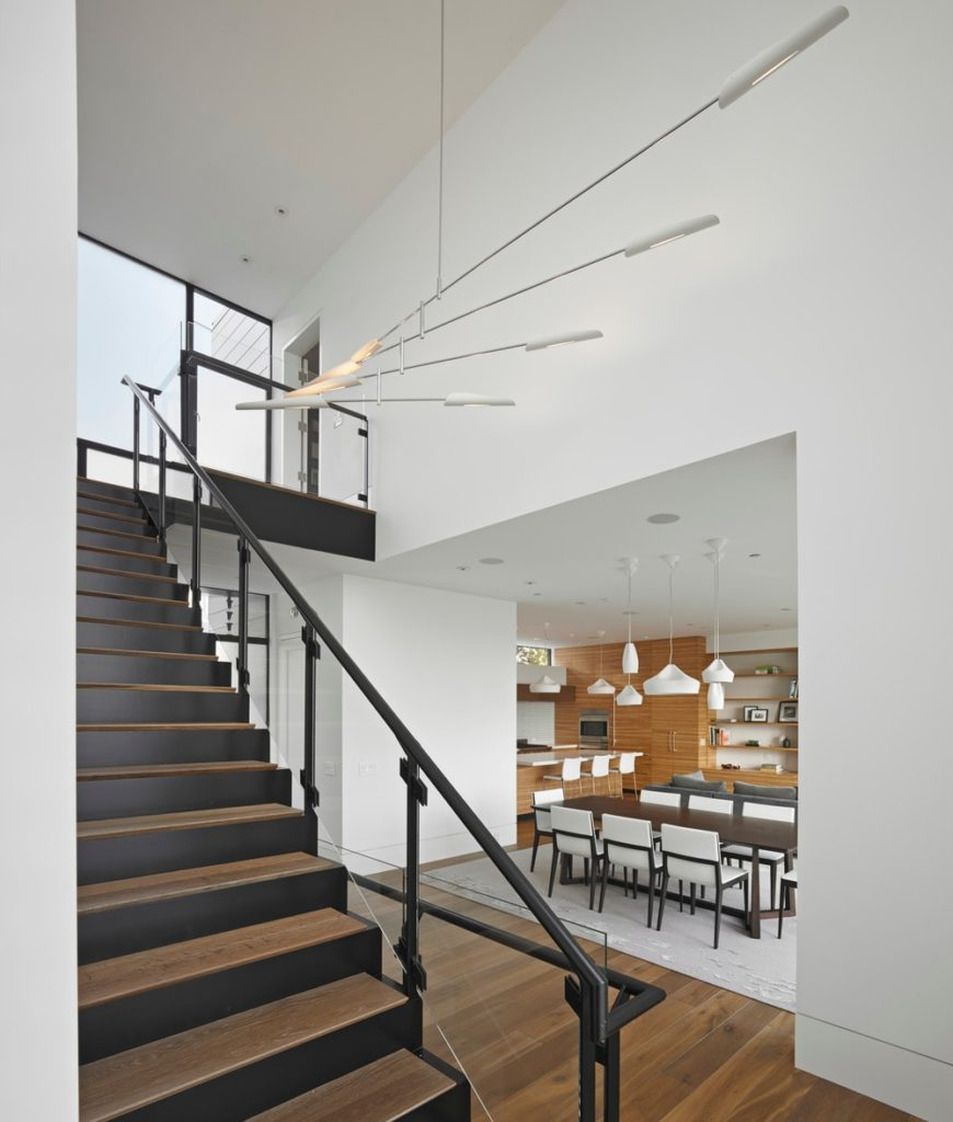 Staircase with white walls and hardwood flooring. Photo credit: Bruce Damonte