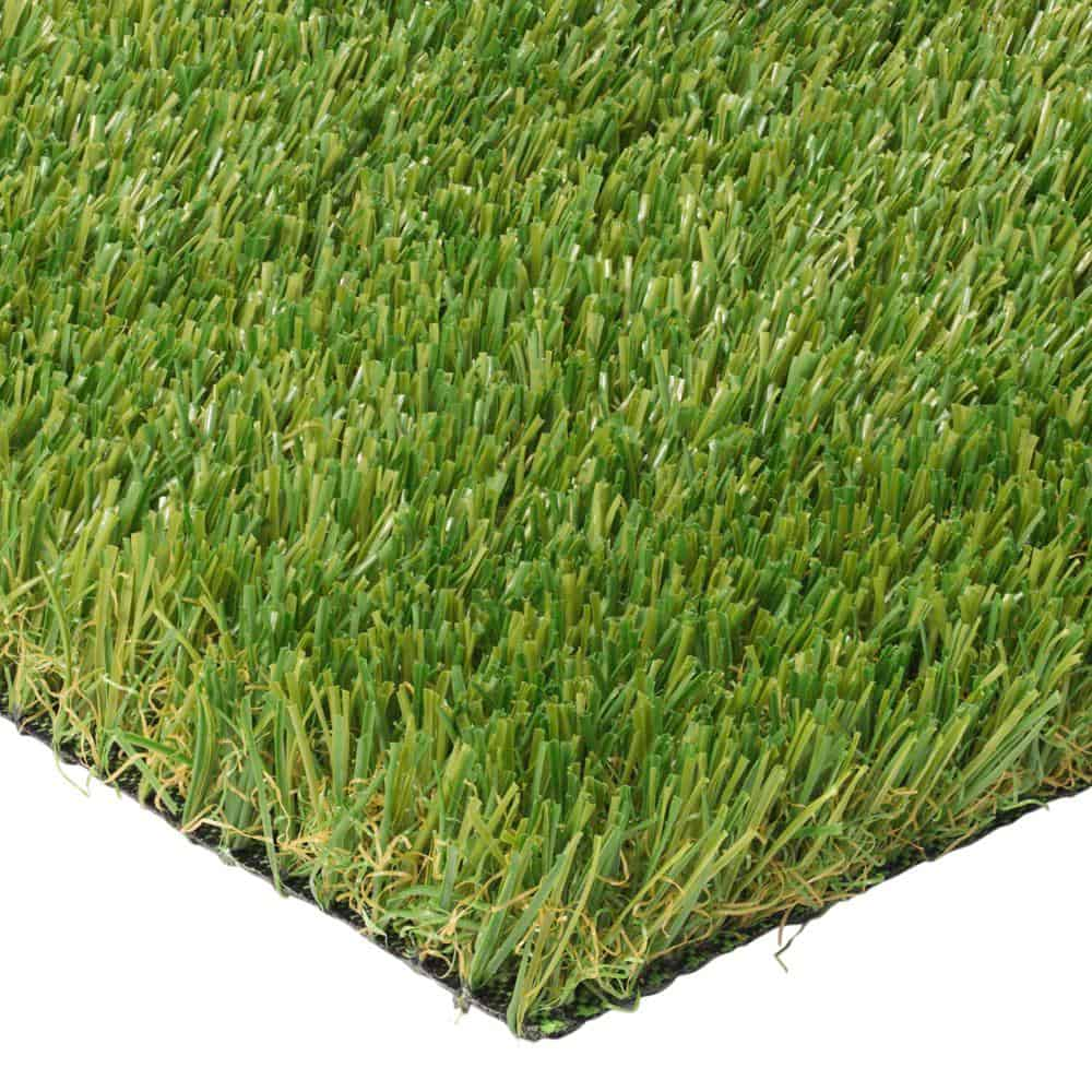 Synthetic grass with a blend of olive and emerald blades.