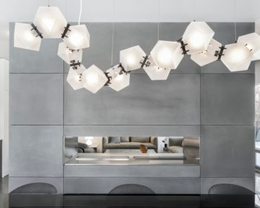Dining area with elegant pendant lights. Photo Credit: Adrien Williams