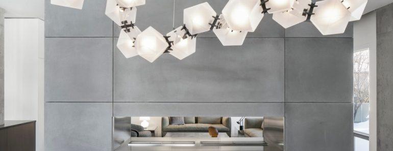 Dining area with elegant pendant lights. Photo Credit: Adrien Williams