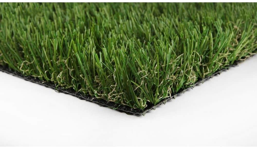 Perforated green synthetic grass carpet.