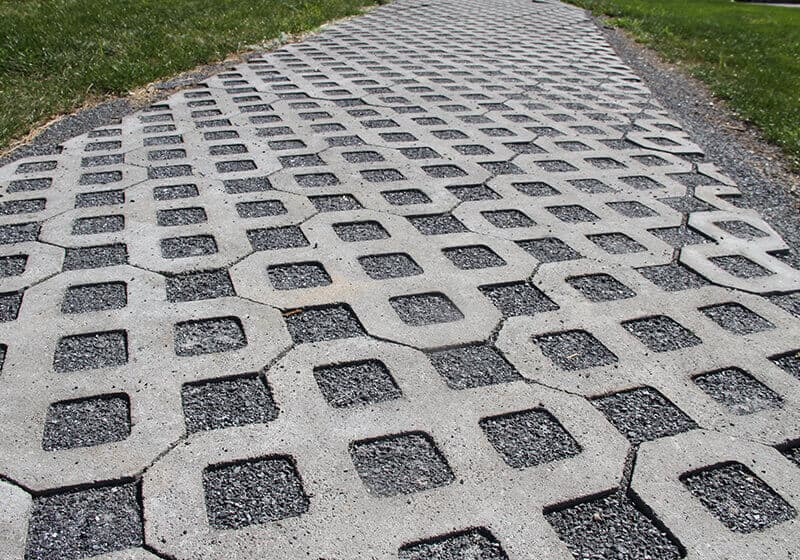 Driveway with gray permeable pavers.