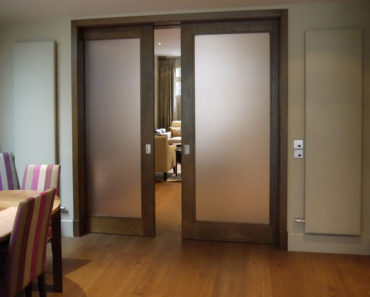 Vintage-type pocket door with frosted glass.