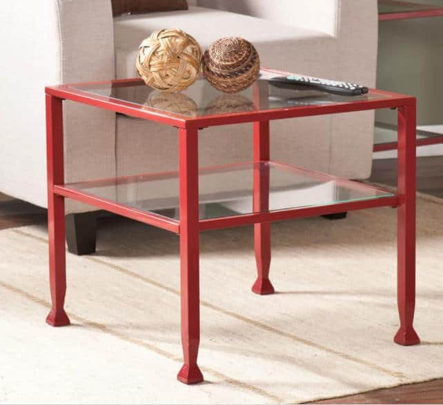 Square coffee table with metallic red frames and a tempered glass top.