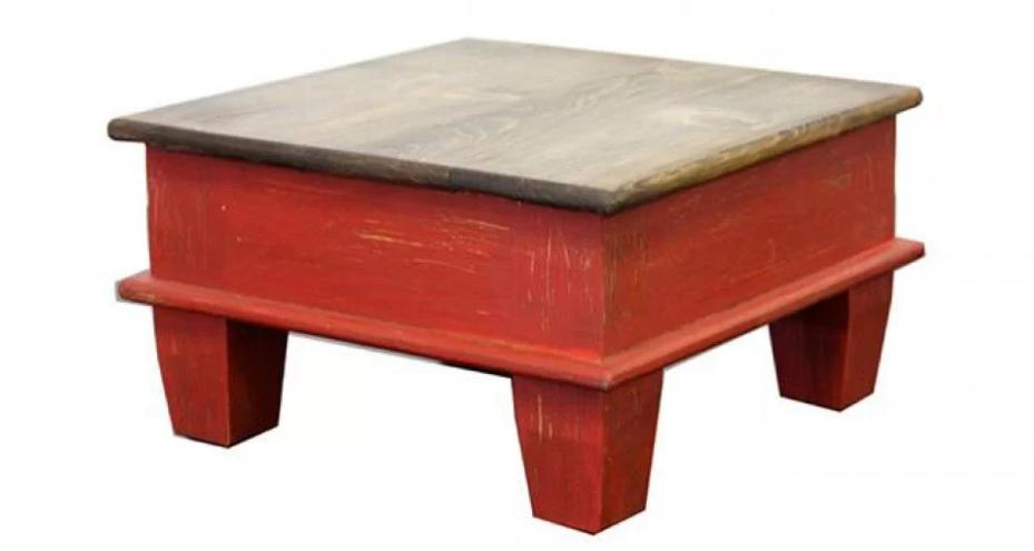 Mini-size, red wooden coffee table with an undone look.