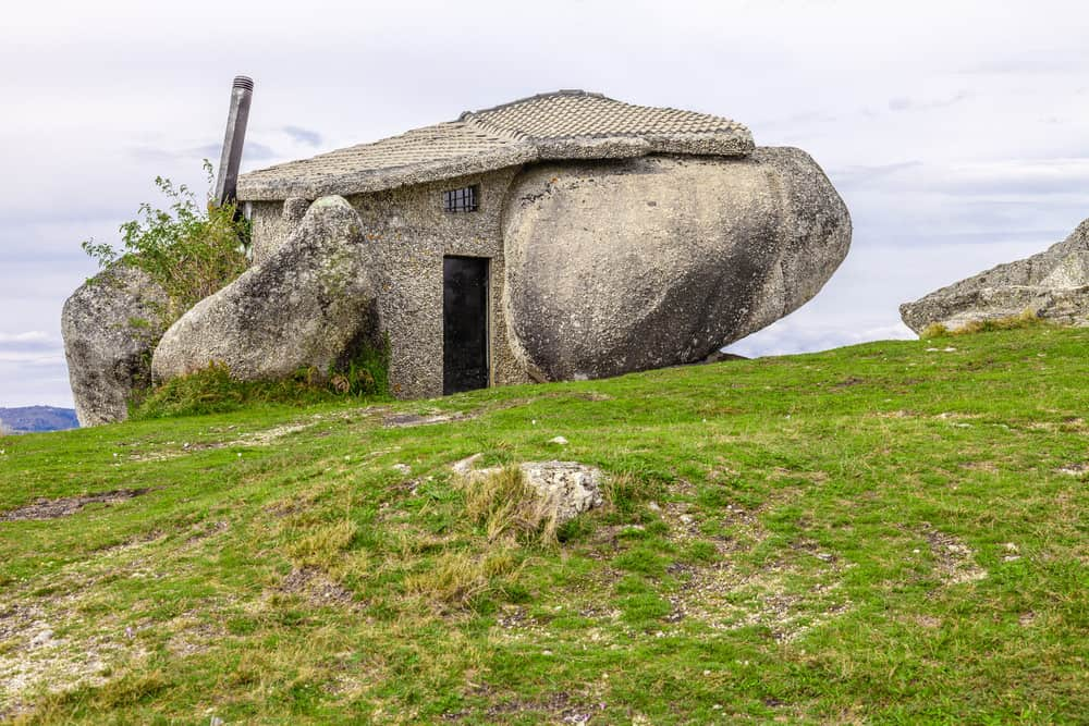 a house (Casa do Penedo) built between huge rocks on top of a mountain in Fafe, Portugal.