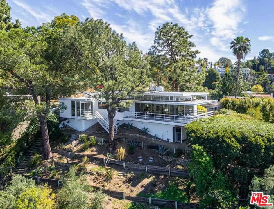 Aerial view of the home showing the beauty of the property in the middle of healthy trees.