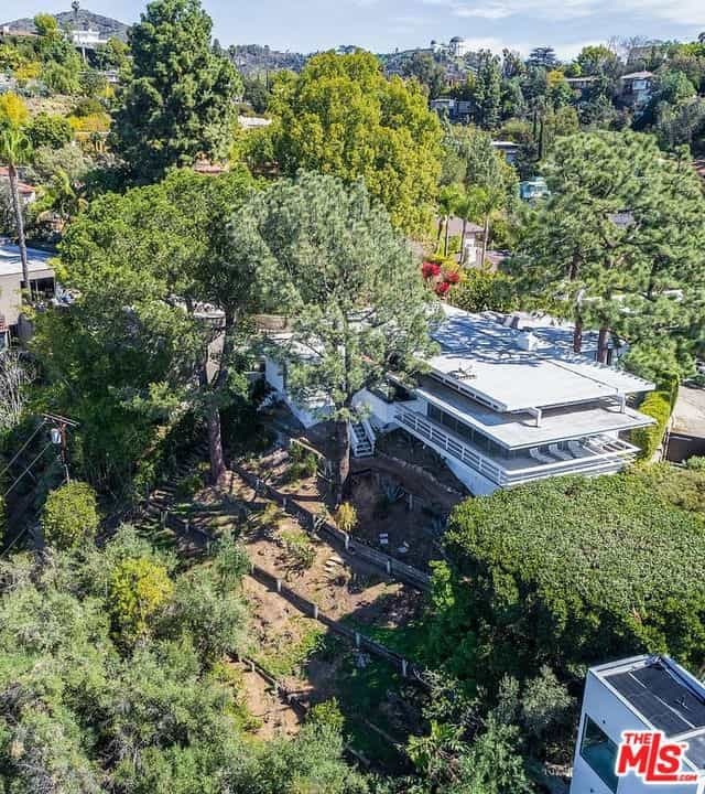 Another aerial view of the house showcasing the stunning area populated by outdoor landscaping.