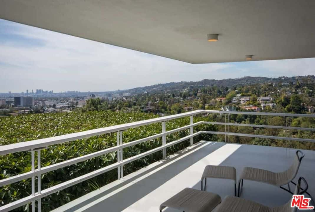 A private balcony patio offers a great relaxing and sight seeing experience.