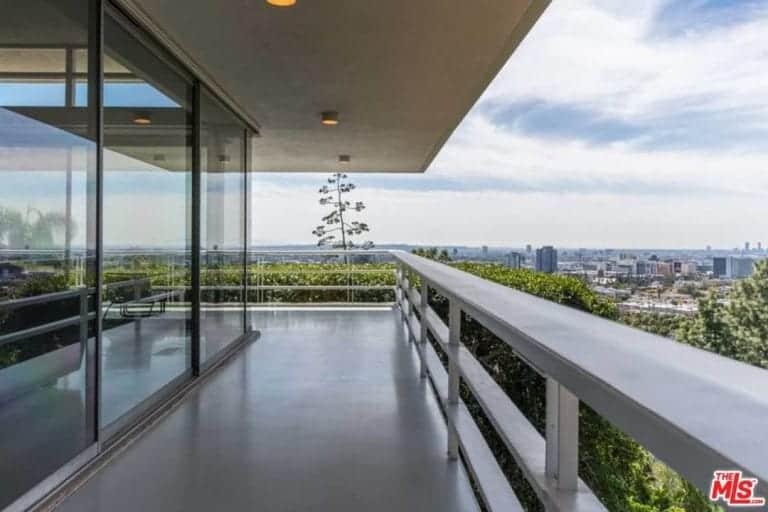 A spacious terrace walkway offers stunning view of the Los Feliz Oaks neighborhood.