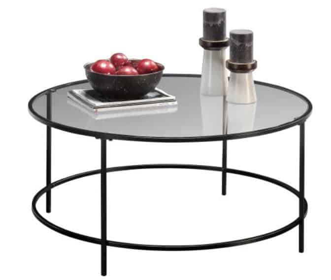 Round coffee table with a glass top and a metal frame.