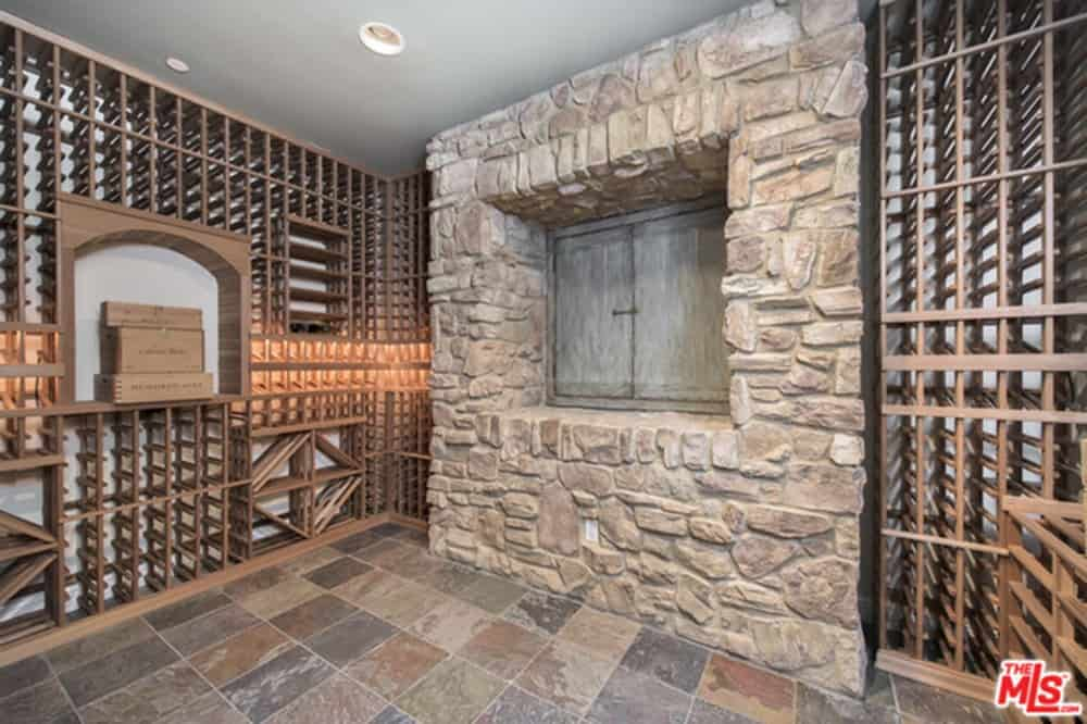 Wine cellar boasts multiple wine racks and tiles flooring.