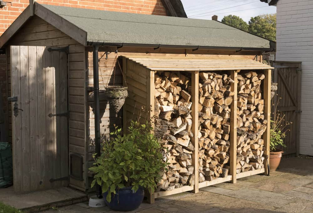 Shed with firewood storage addition