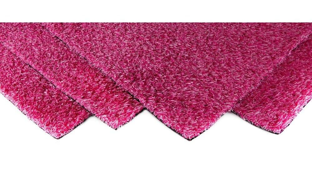 Short, synthetic grass carpet in a bright pink blend.