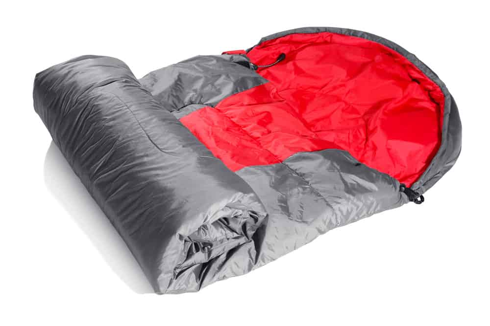 Silver sleeping bag with red interior