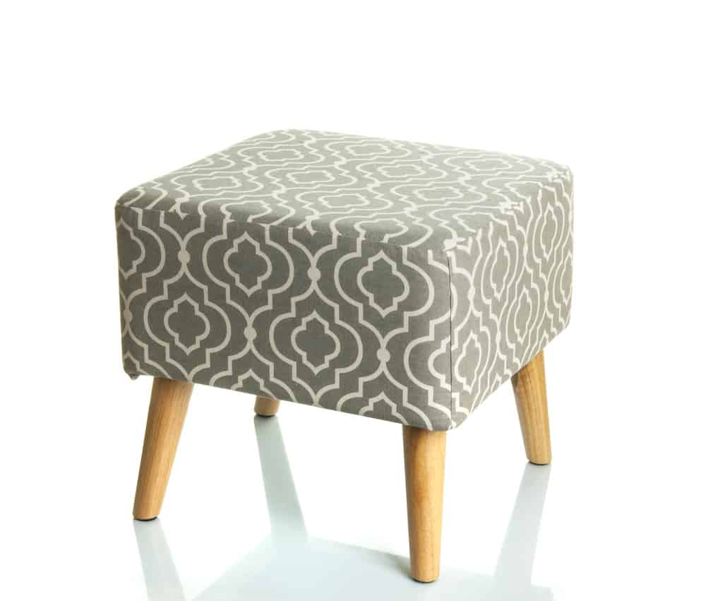 Hassock with exposed light wood legs