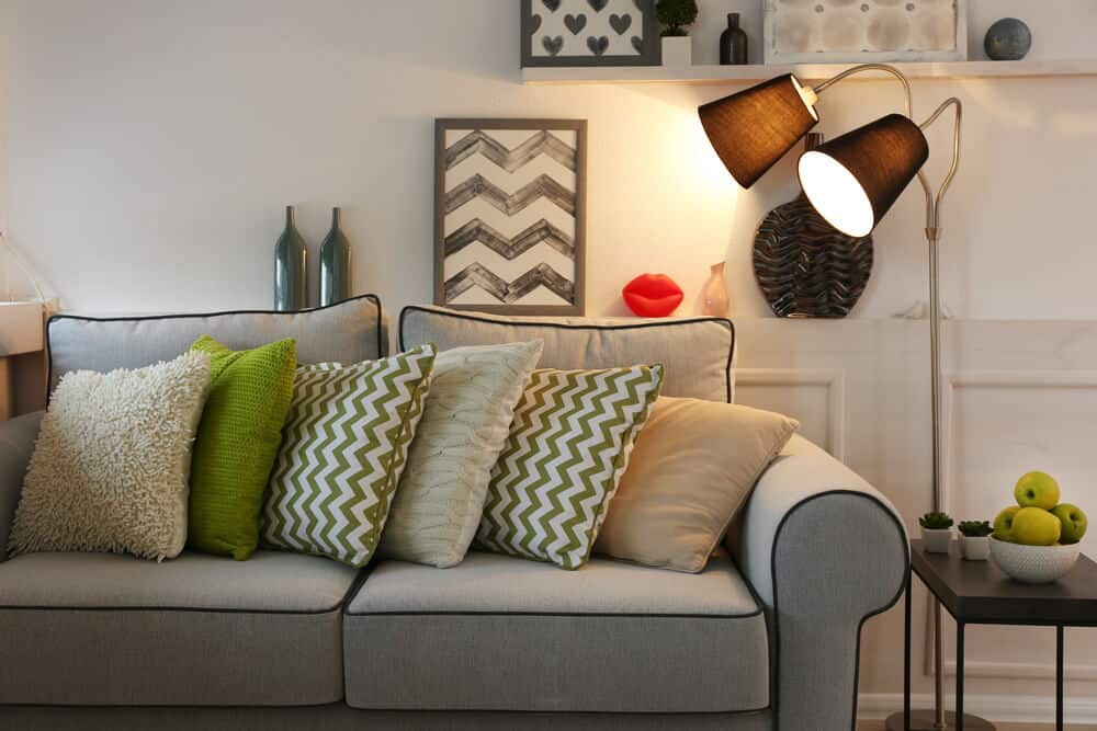Standard sofa in gray with printed pillows.