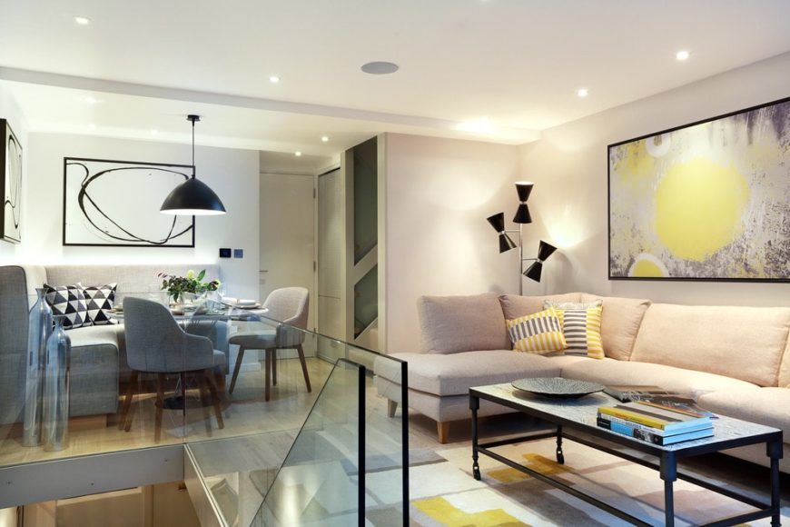 Contemporary living room with an elegant sofa set along with stylish lighting and wall decor. Photo credit: Alex Maguire
