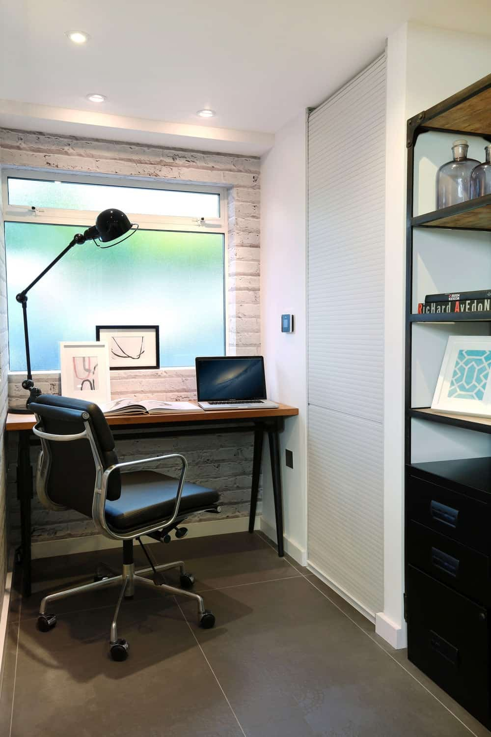 Another example of a tiny computer station in a home that works in a tiny space. Original brick wall retained but painted white. Recessed lighting nicely illuminates the space