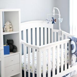 White convertible crib in baby nursery