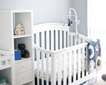 White convertible crib in baby nursery