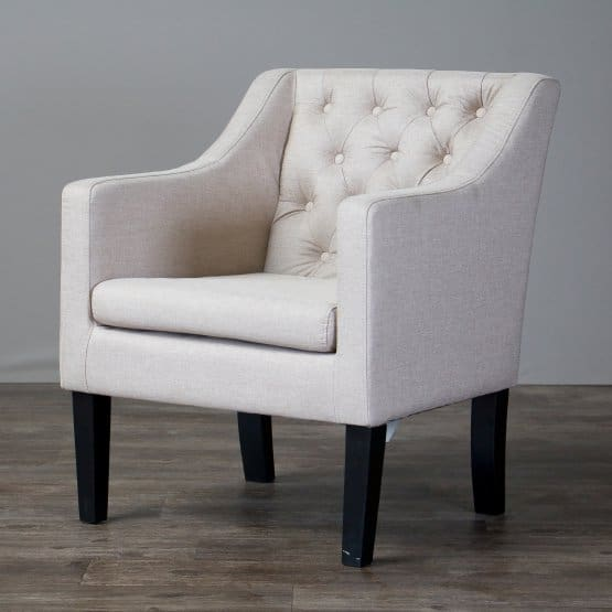 White linen club chair with some classic details.