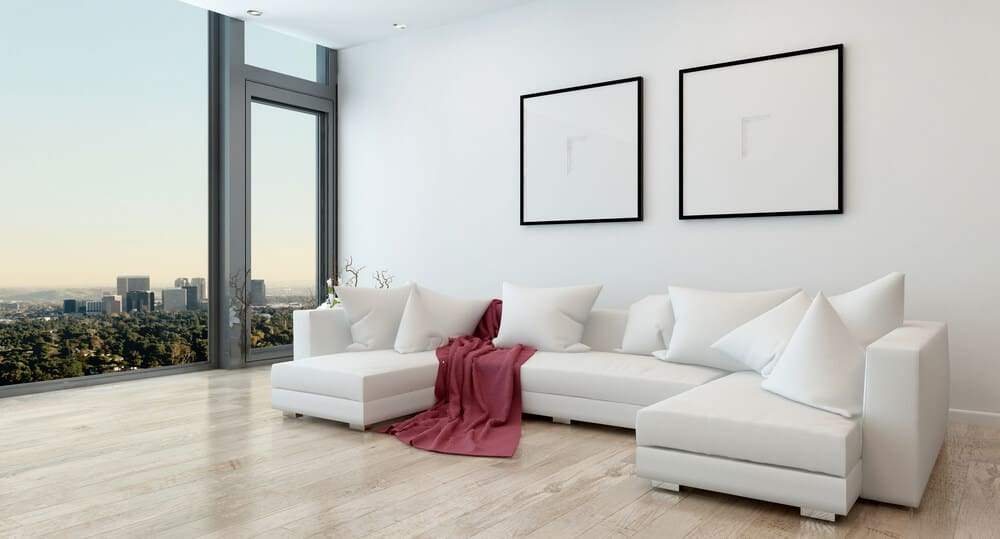 White sectional sofa in a minimalistic living room.