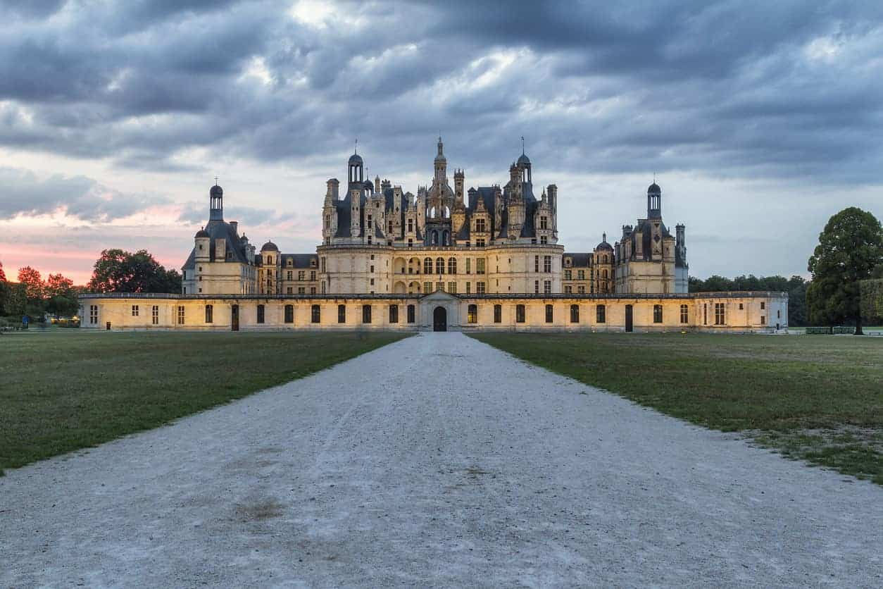 Chambord Castle at sunset. Built as a hunting lodge for King Francois I, between 1519 and 1539, this castle is the largest and most frequented of the Loire Valley.