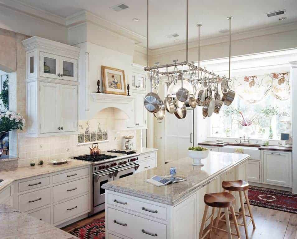 White kitchen with incredible pot rack.