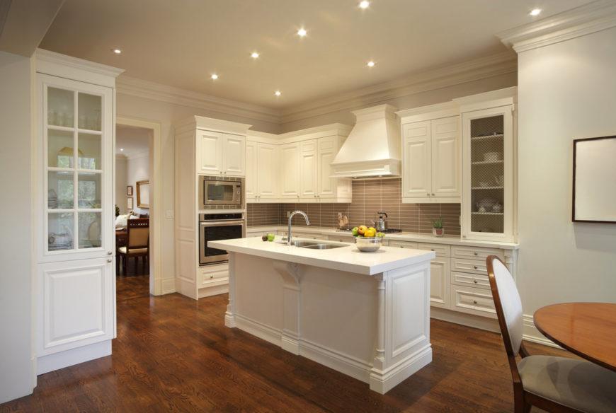 White kitchen with narrow white kitchen island