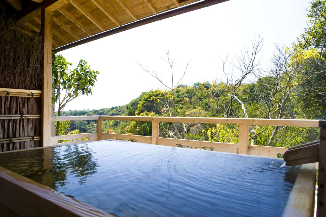This outdoor bathtub area features a jaw-dropping view of the bewitching surroundings.