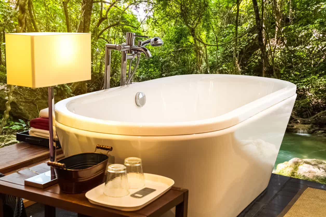A large freestanding tub set on the outdoors of the property. It offers a staggering nature's view while soaking in the tub.