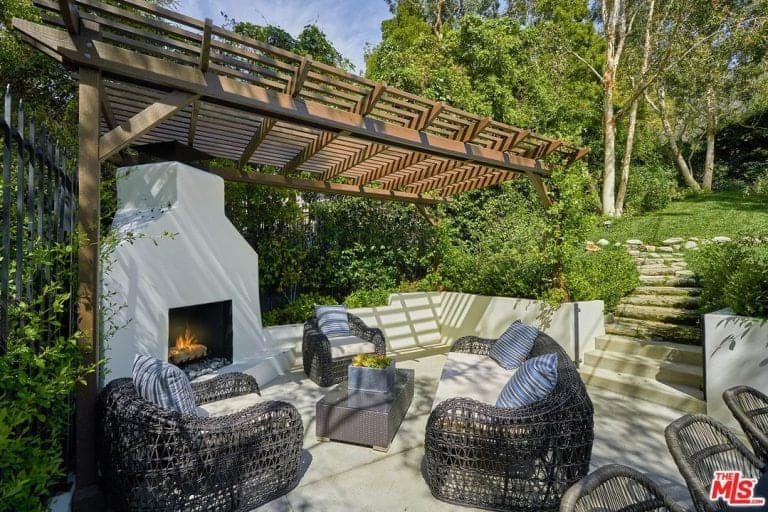 There's also a pergola outside featuring nice sitting place with a fireplace keeping the temperature warm.