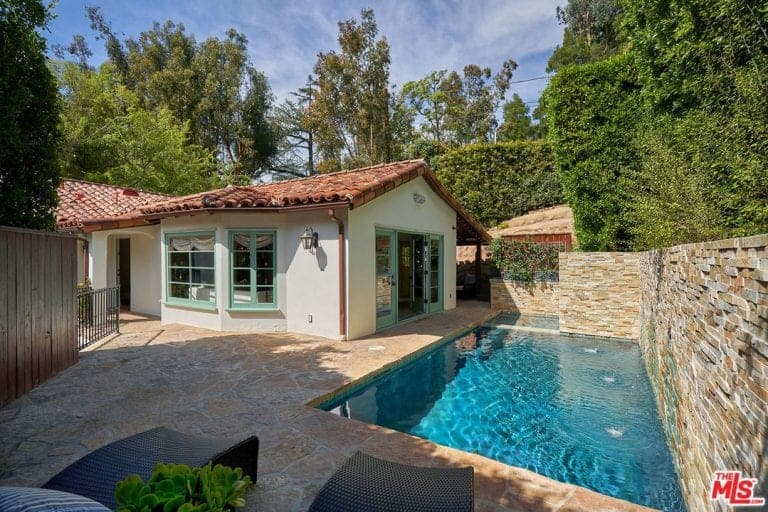 The house also features a small rectangular pool with a stylish seating lounges.
